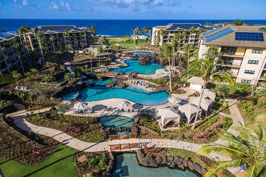 Bird's eye view of resort with pools, landscape, and cabanas