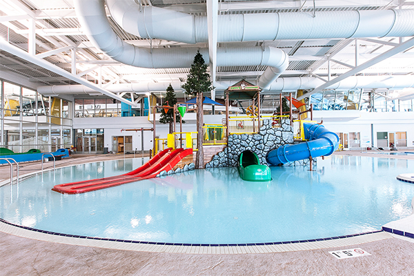 shallow Children's pool area with colorful slides and water features